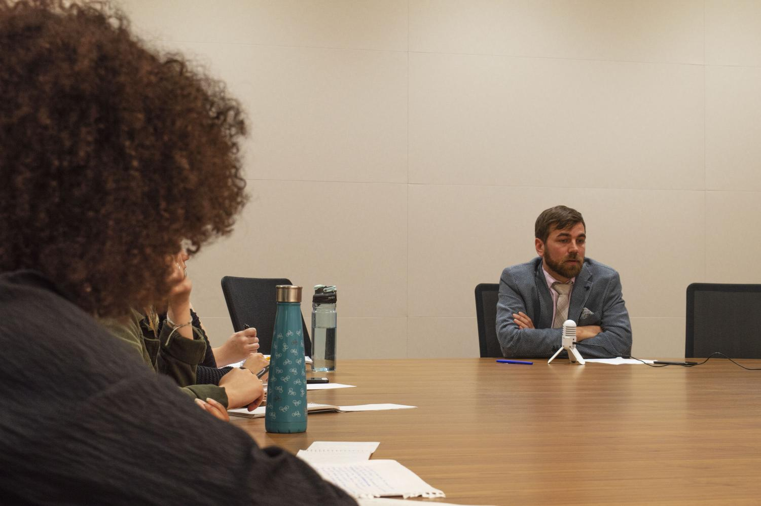 Journalism and Radio Ops students listen to Dean Brian Norman during a press conference.