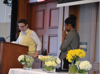 Shauna Deleon beams as Dean Sarah Neill reads the nominations other students wrote.