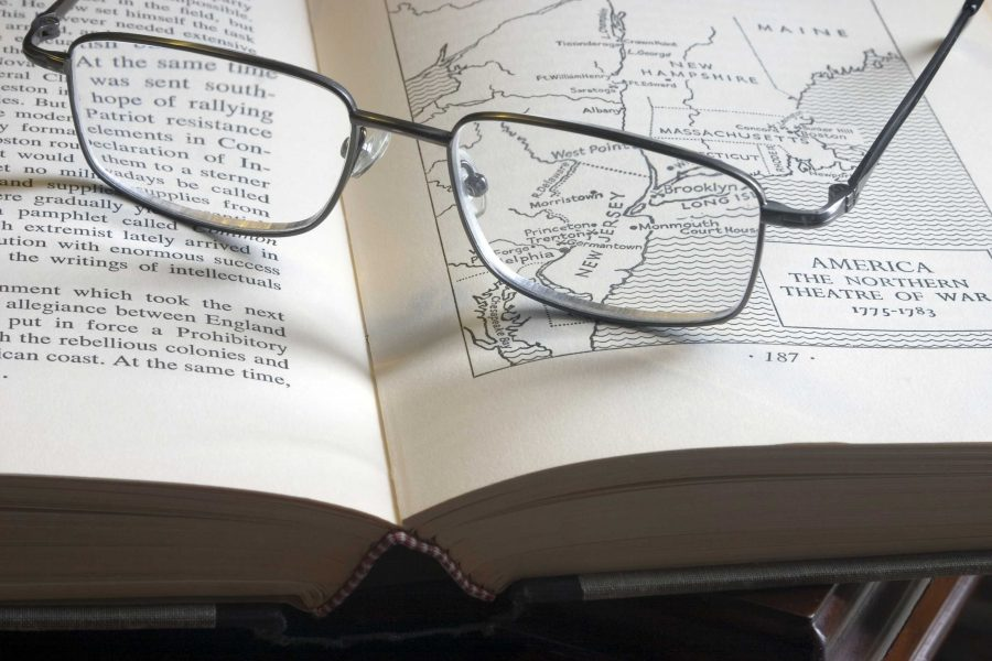pic of glasses on a history book