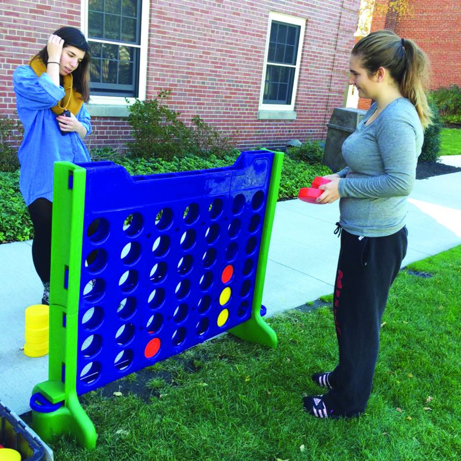 Students playing life-size Connect-Four