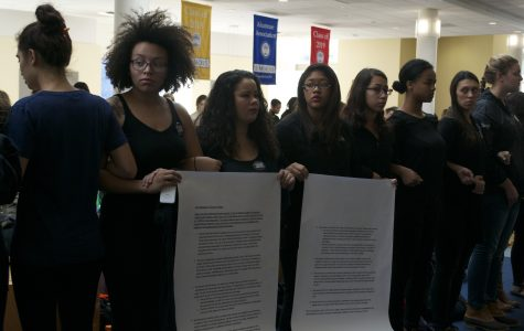 Students holding posters that list the demands