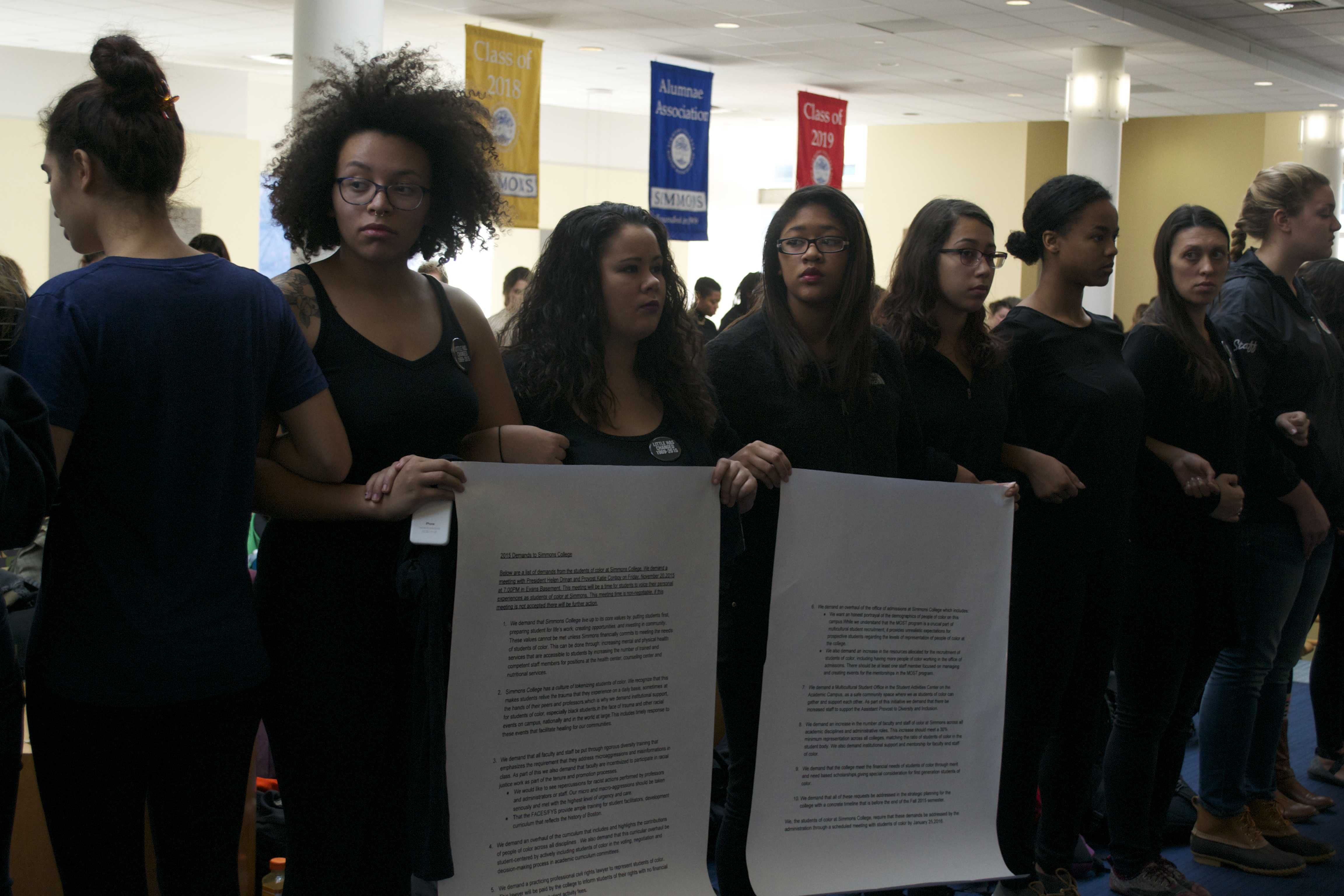 Students gather in the Main College Building with a list of demands for the administration.