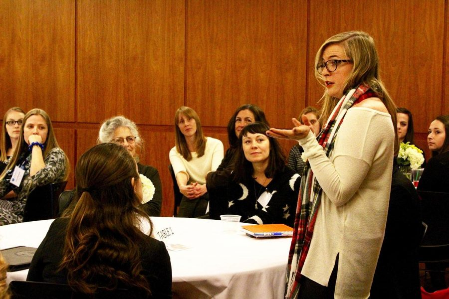 Stephanie Paulovich, '11 Simmons alum, introduces herself at the PRSSA Networking Dinner. (Photo by Alisha Morales)