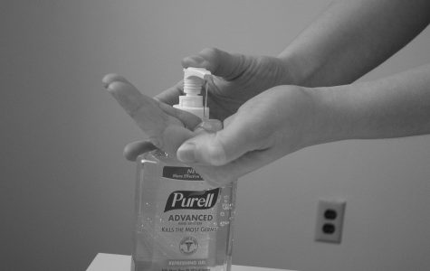 A person putting Purell into their hands