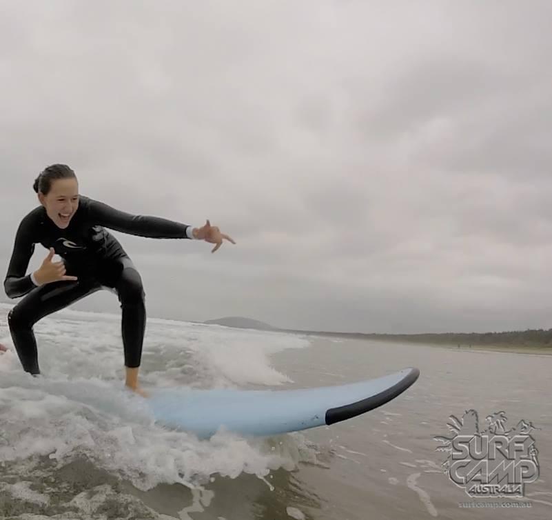 The author surfs off the coast of Austrailia