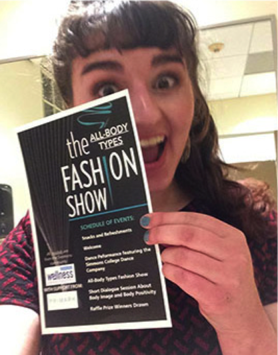 Charlotte Zelz '19 excitedly holds up the fashion show's pamphlet before getting ready. Photo: Charlotte Zelz