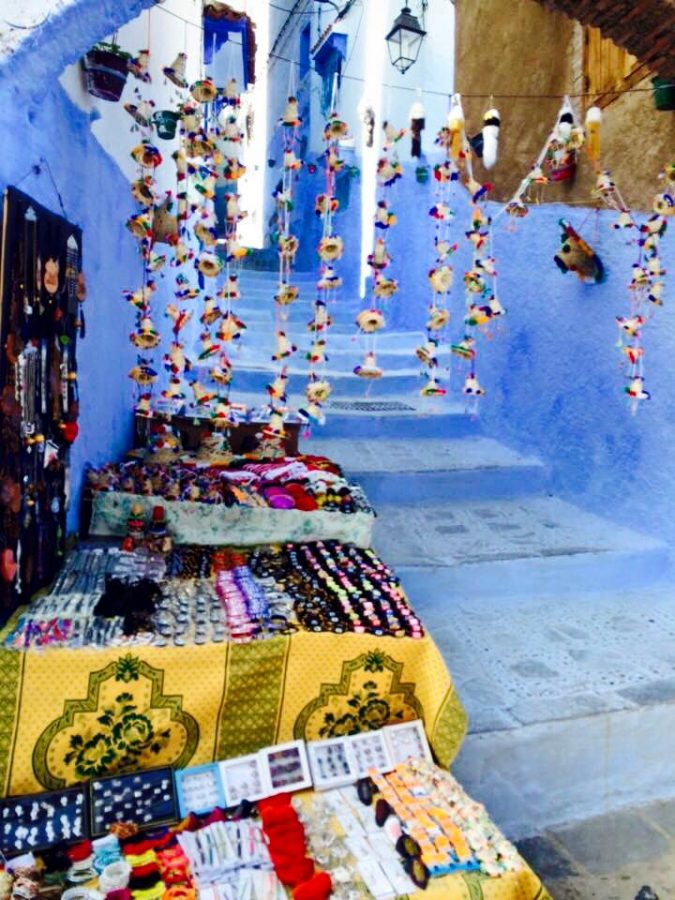 A marketplace in Morocco, with tapestries and hanging beads