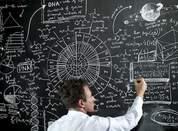 teacher writing equations on the black board
