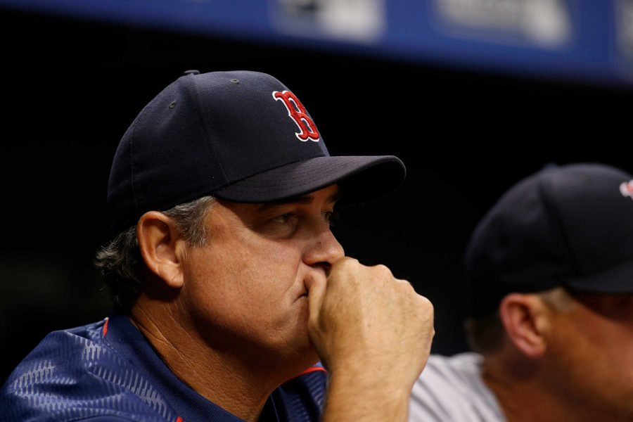 ST. PETERSBURG, FL - AUGUST 8:  Manager John Farrell #53 of the Boston Red Sox looks on from the dugout during the fifth inning of a game against the Tampa Bay Rays on August 8, 2017 at Tropicana Field in St. Petersburg, Florida. (Photo by Brian Blanco/Getty Images)