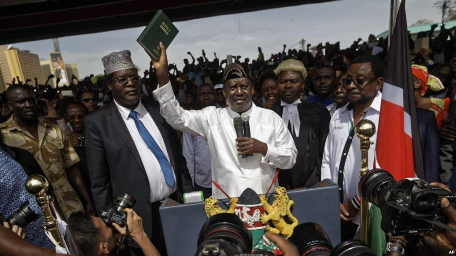 "Kenyan opposition leader Raila Odinga inaugurates himself as the ""people's president"""