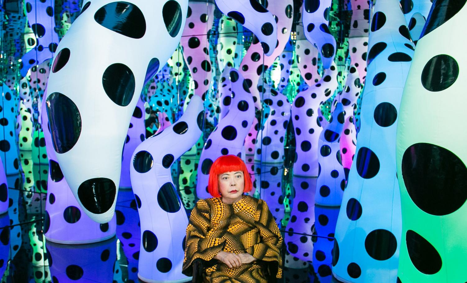 Yayoi Kusama pictured with her work LOVE IS CALLING, 2013 during her solo exhibition I Who Have Arrived In Heaven at David Zwirner, New York, 2013. © YAYOI KUSAMA. Courtesy David Zwirner, New York; Ota Fine Arts, Tokyo/Singapore /Shanghai; Victoria Miro, London/Venice
