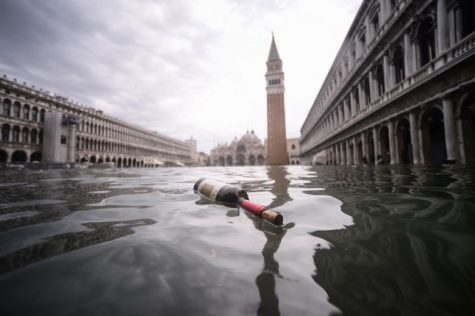 A general view shows a bottle of wine floating on the water of the flooded St. Mark